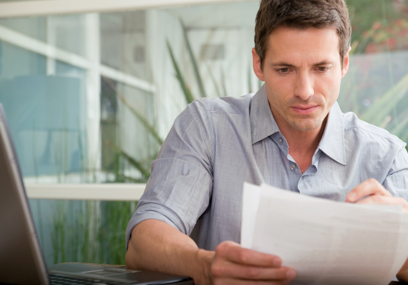 man reading important documents